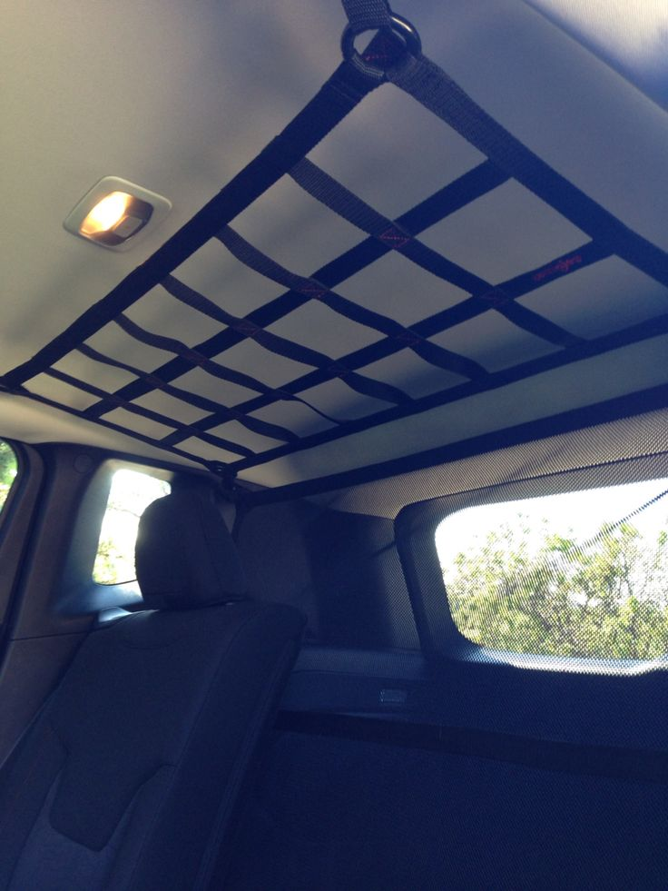 New barriers, cargo and ceiling nets for the Jeep Renegade. Pepper approved. Come see us next Saturday at the Pollard Jeep summer event! #RAINGLERNETS #POLLARDJEEP #JEEPRENEGADE http://www.raingler.com/#!jeep-merchandise/ch9y