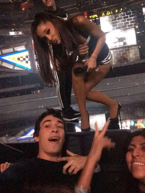 Ariana taking a selfie with fans during performing at the ...