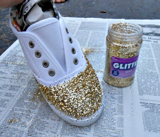 What you'll need: -Any pair of flats, canvas shoes, or loafers -Mod Podge (available at craft stores) -Glitter (gold, silver, etc.) -Newspaper & a plate or bowl -Foam brushes or paint brushes -Clear coat spray paint (to make sure the glitter stays on!) First, you'll want to stuff newspaper down into the shoe so that no glitter or glue gets inside! I removed the laces from my shoes also, just to make sure they didn't get all gunked up. Pour some of the mod podge onto a plate or into a bo...