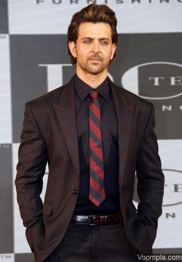 Hrithik Roshan looks hot in a dotted black suit with burgundy hues, striped tie and a black shirt. via Voompla.com