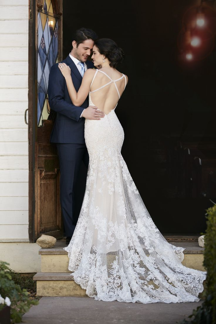This sheath wedding gown from Martina Liana is made from sparkling beaded lace over Imperial crepe and boasts a sweetheart neckline with flirty shoulder straps that gather at the shoulder blades. The low-cut back zips up under crystal buttons. (sp)