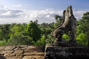Stone Lion Guardian with forest and sky skyline at Pre Rup, The East Baray, Siem Reap, Cambodia #cambodia #sacredsites #sacredtravel #spiritualjourneys #sacredmysticaljourneys