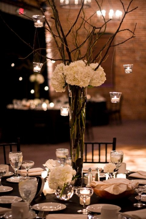 tall centerpiece with smaller arrangement...not sure about hanging canldes though