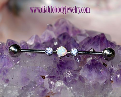 Anatometal High Polish Titanium Industrial Barbell with Removable Threaded Prong Set Gems. Threaded Ball Ends. Colors in photo: Tanzanite, and White Opal