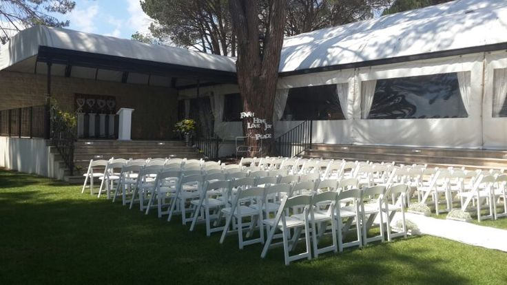 Forest themed wedding - the outside Ceremony area with Wimbledon chairs and white isle runner