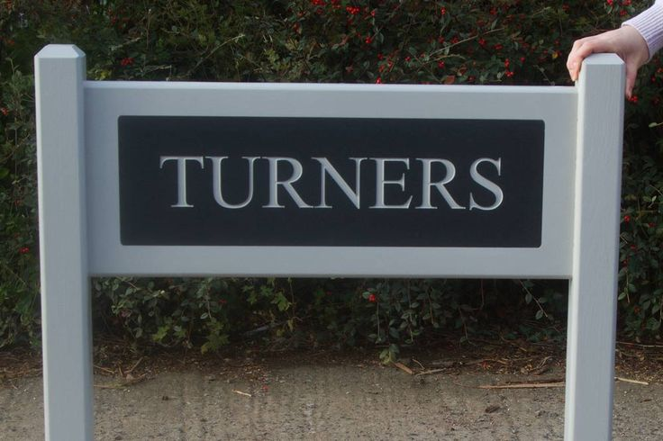 Superior Entrance Signs - These are made from solid oak which can be painted or varnished. The corian has the lettering engraved and painted. It is then inlaid into the oak.  The one in the photo has the oak and lettering paint in Farrow and Ball colour Purbeck Stone. The corian is dark slate. http://www.sign-maker.net/entrance-signs-oak-corian.html