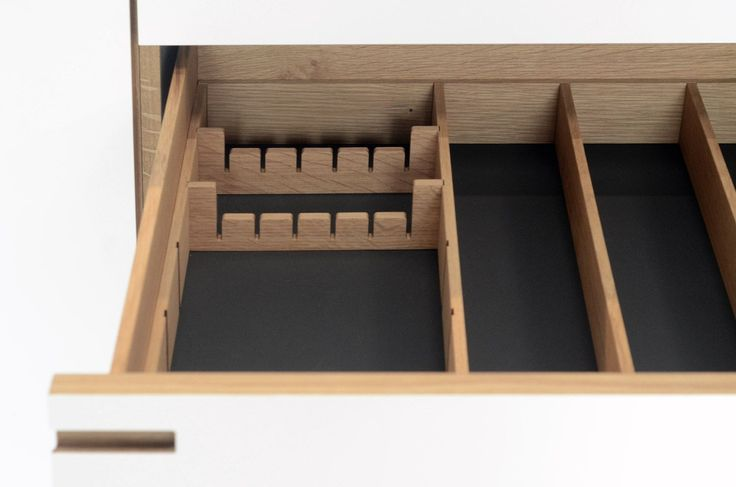 White laminate and oak  - a drawer for knives and utensils.