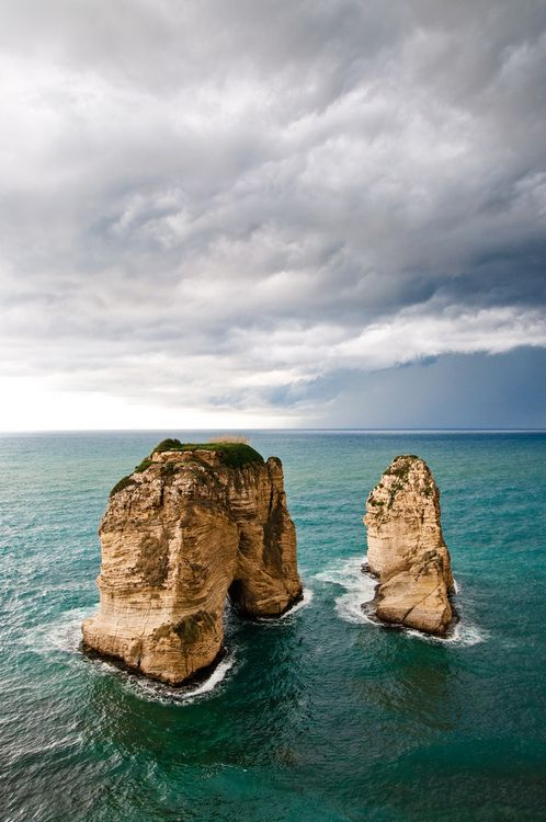 Pigeon Rock. Beirut, Lebanon.  The natural offshore rock arches of Pigeon Rocks are the most famous, and indeed one of the many, natural features of Beirut.