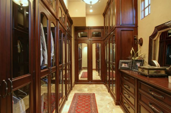 Mediterranean-inspired walk-closet with mirrored doors and high ceiling #walkinrobes