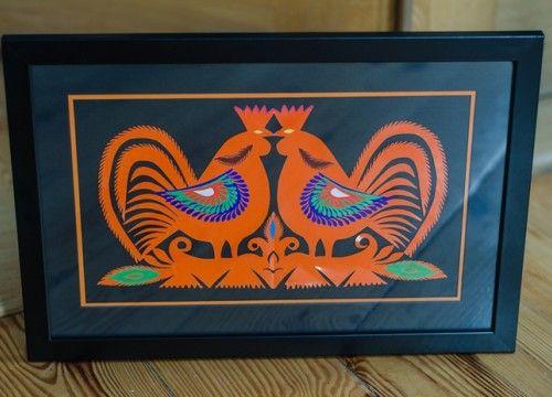 Orange Kurpie hand-made cocks. Polish handicraft
