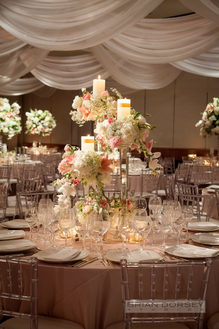 Elegant floral centerpiece with candles See the
