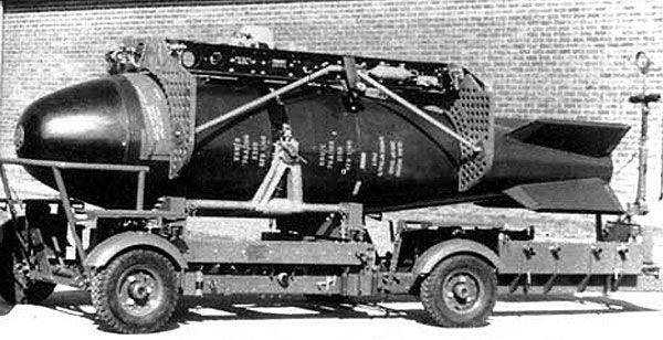 """British - """"Red Beard"""" was a 15 kt Tactical Atomic Bomb - Designed to be Carried by the English Electric Canberra and the V Bombers – the Weapon is Shown on its Bomb Trolley, Fitted with a Bomb Carrier Prior to Loading into an English Electric Canberra Bomber - The 2 Fore and Aft Vertical Plates Shown with Holes in Them were Baffles Unique to the Canberra Installation, Designed to Reduce Air Stream Buffeting that could Tear Off the Bomb Door"""