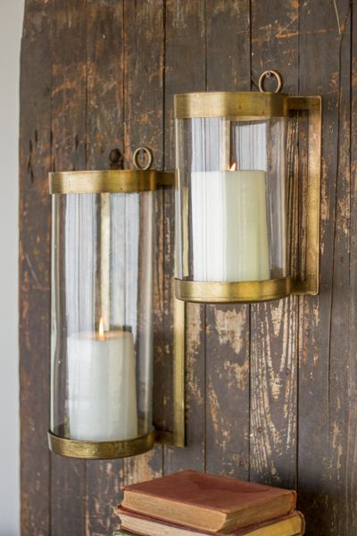 Click to shop candle holders by Hudson and Vine. Classic home decor to bring soft illumination to your farmhouse, french country, Tuscan, Vintage, Industrial or Bohemian interior design style. Glass & Antique Brass Finish Wall Mounted Hurricanes - Hudson and Vine