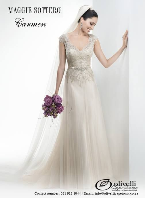 Vintage Swarovski crystal embellished lace and tulle overlay this Valentina satin slip dress. Fabric covered buttons lead down to a satin waistband, adorned with Swarovski crystal appliqués. #MaggieSottero #OlivelliCT #WeddingGown