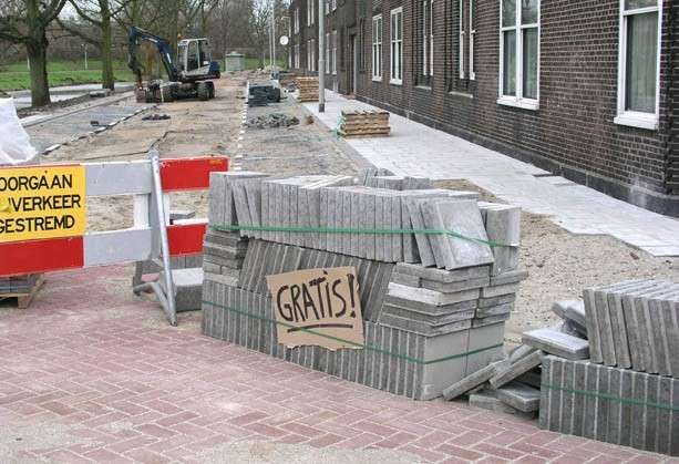 Harmen de Hoop, 'for free!' (2005) A sign added to a pile of paving stones.