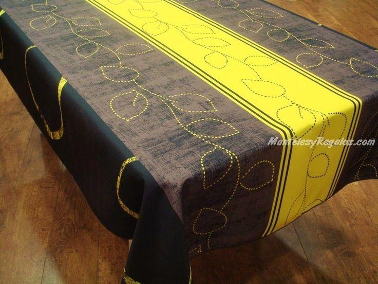 Manteles antimanchas y antiarrugas. Mantel Antimanchas de poliéster modelo HOJAS PUNTOS color amarillo. Tejido 100 % poliéster y acabado con biés. Múltiples medidas para elegir (manteles rectangulares, ovalados, redondos y cuadrados).
