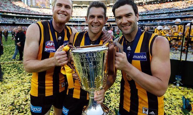 Jarryd Roughead, Luke Hodge and Jordan Lewis.