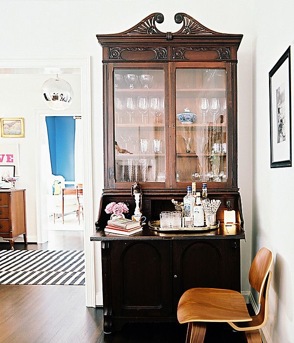 Give an antique secretary or cabinet new life by turning into an at home bar!