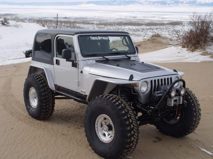 Beautiful Jeep Wrangler TJ with tube fenders on the beach.