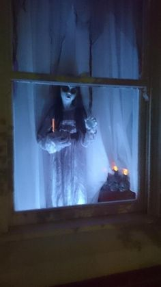 Halloween ghost girl in window prop by new Halloween Forum member(from the land down under)AussieBoo