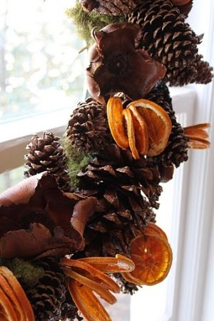 Pinecone garland with dried lemon/orange slices. | www.oldtimepottery.com by J.E.K.