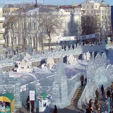 Urals. Yekaterinburg's 2004. The arch marks the entrance to the Ice Village centerpiece: an exhibit of award-winning ice and snow sculptures. To the immediate left of arch, the ice labyrinth.: Ice Sculptures, Ice Snow Sculpture