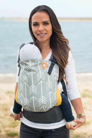 Tula baby carrier....I prefer way more than a wrap. Works well for moms and dads and for petite to plus size parents to baby wear.
