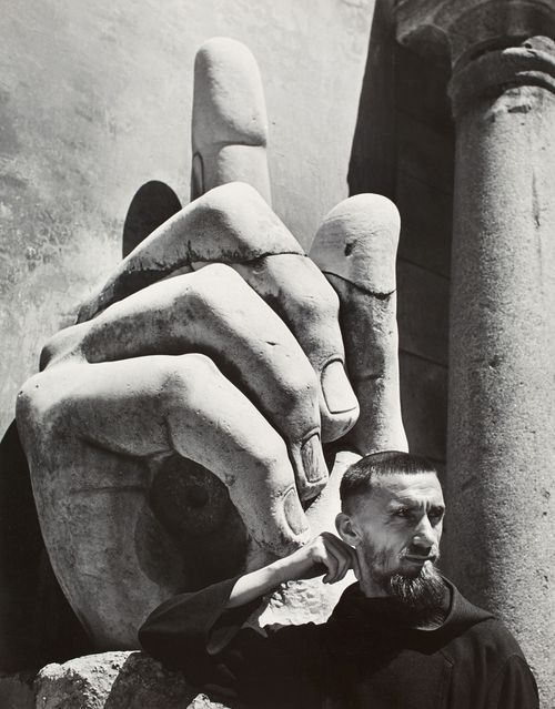 Herbert LIST :: Finger of God, 1949 / A monk underneath the hand of the monumental statue of the Emperor Constantine, in the courtyard of the Palazzo Conservatori.