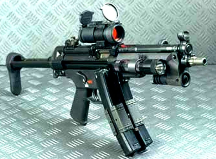 Heckler and Koch HK94 MP5A3 9mm 30rd. My dream gun, w/o the suppressor though.