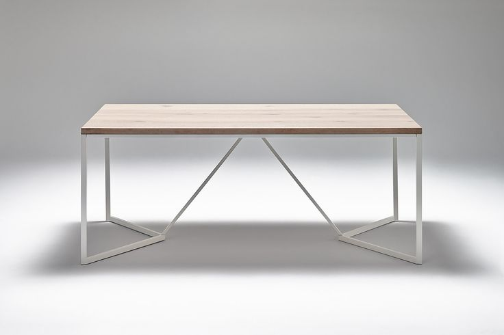 Nevian dining table; Graphic. Whitewashed oak and white steel base.