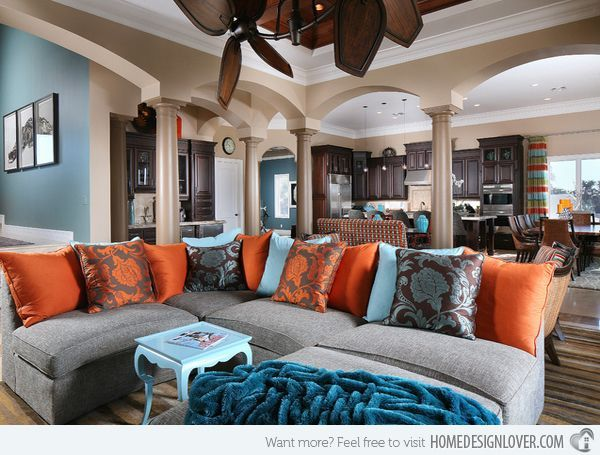 15 Stunning Living Room Designs with Brown, Blue and Orange Accents- not big on the pattern on the pillows but the over all color scheme is awesome!