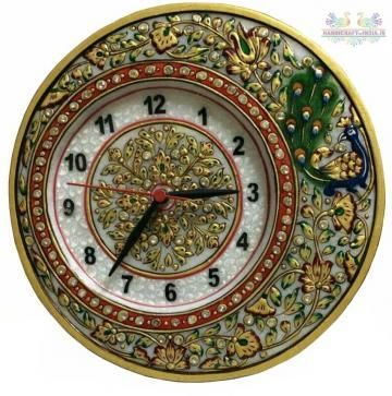 This handcrafted corner clock is made of pure Makrana marble (sangmarmar), gold painted and decorated with colourful beads. The clock is fixed in the round marble ball. It is an exclusive show piece for your drawing room; sure to be admired by your guests.