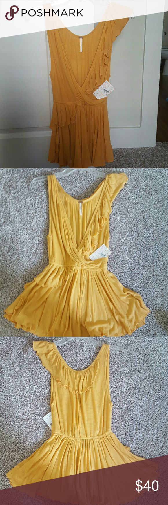 Free People Mango Ruffled Shirt Adorable and brand new! zero flaws. Great for Easter Sunday or a first date! Wonderful for an audition too! Pair with skinny keans, leggings or a short skirt! Free People Tops