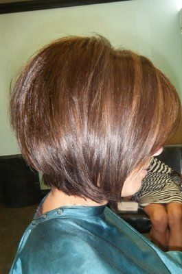 Short layered bob. I will get my hair cut like this one day, when I have outgrown my long hair phase.