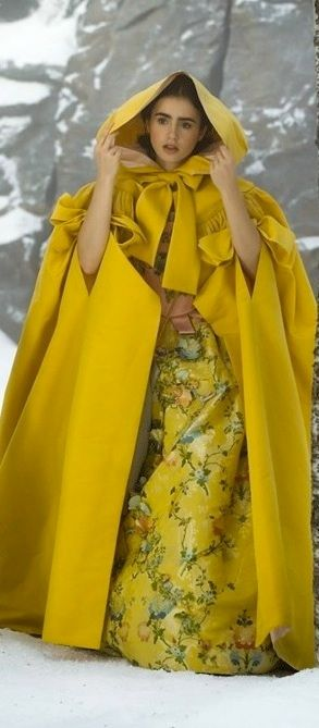 Lily Collins as Snow White in her yellow cloak. 'Mirror Mirror' (2012), Costume Designer: Eiko Ishioka                                                                                                                                                      More
