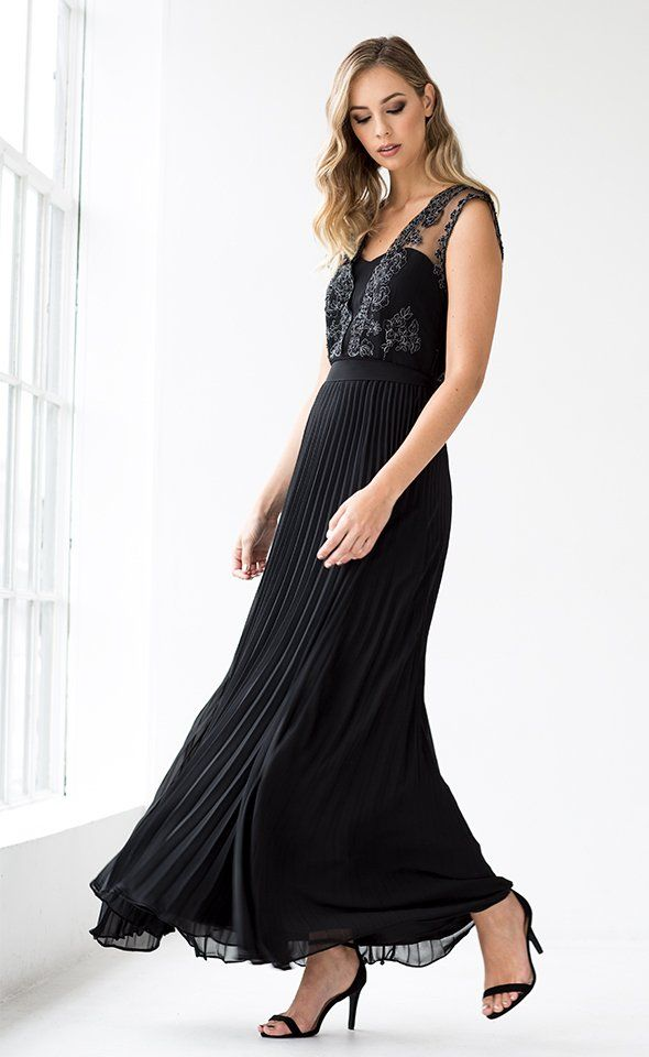 The Premium Catherine Gown is a truly stunning gown that is perfect for your next extra special occasion. The fitted bodice is constructed to flatter and features wide embellished sheer straps that overlay. The waist is then cinched with a lustrous waist tie which creates a stunning silhouette. Finished with a pleated skirt that's designed to elongate your figure and guarantees that each step is filled with movement.