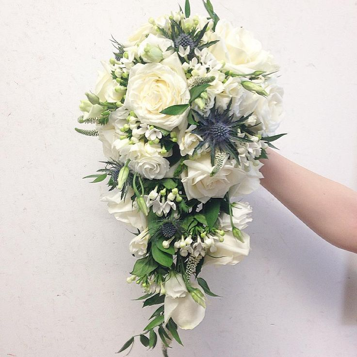 Today's bridal bouquet #wedding #flowers #weddingflowers #glasgowflorist #ivory #blue #roses #thistle #lisianthus #freesia #bouvardia #bridal #bouquet