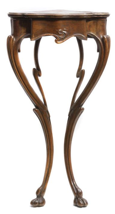 An Art Nouveau walnut corner console