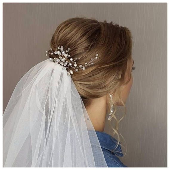 Delicious wedding hair piece, simple and elegant. This bridal hair accessory will underline the elegance of your wedding hairstyle. This stylish bridal hair pin created with shiny crystal beads and pearl beads, silver wire. This exqiusite bridal hair brooch is perfect on both dark