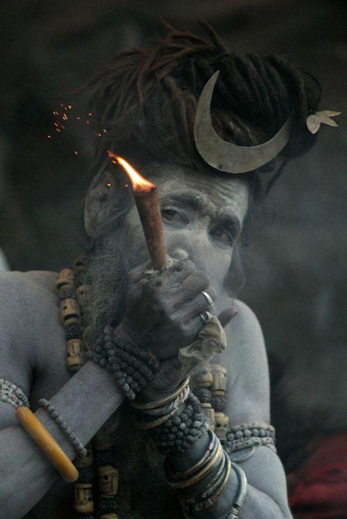 Aghori, smoking out of a chillum / found viaNischal Karki