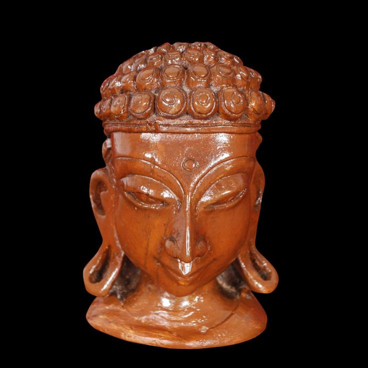 This sculpture has been carved from a single piece of #Wood. There is no joint or pasting in this figure. This is very fine piece of #Buddha Head.	  Buy Now!!! http://www.tagoresculpture.com/product.php?cat=2&pro=10