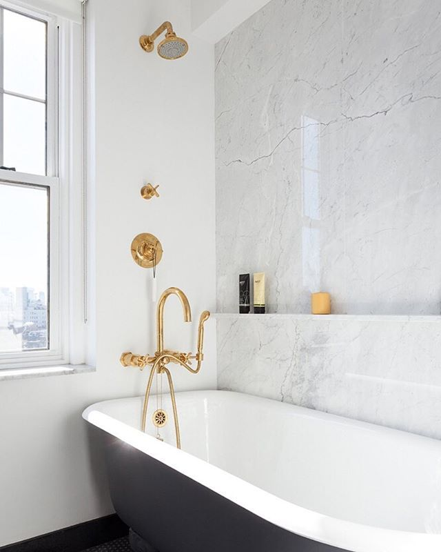 Loving this gold + marble + charcoal #bathroom designed by @ashe_leandro, complete with @wtrwrks fixtures and @madeamano floor tiles.