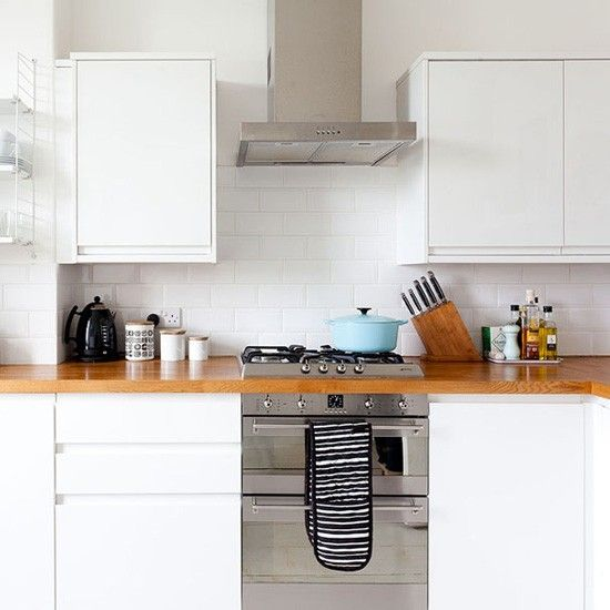 Take a tour of this smart tenement flat kitchen unit for Small white galley kitchens