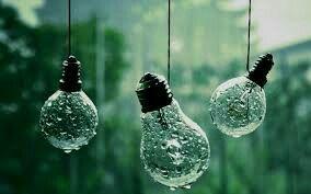 Rain drops fall upon light bulbs  It looks so adorable