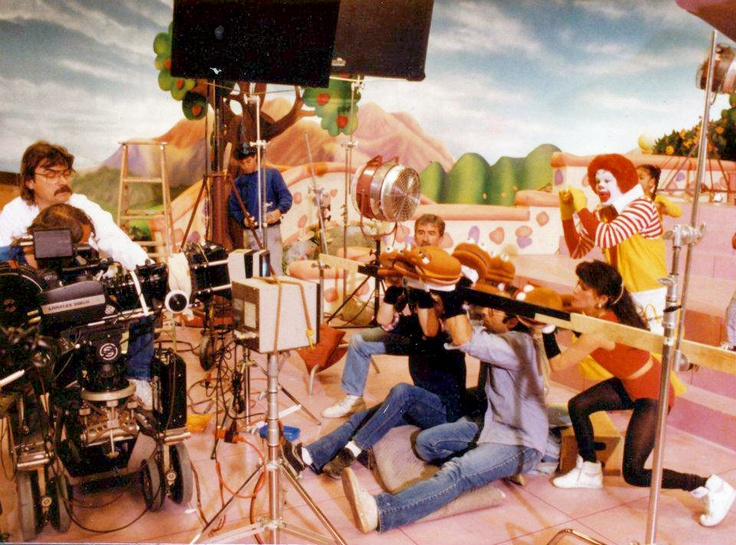 """Cool!  ...1988 - The Hamburger Puppets filming a scene from a commercial called """"Singing Our New Song"""". The theme song introduced was """"The Good Time Great Taste of McDonald's"""". The 5 second part of the song that the Hamburger Puppets were singing goes like this: """"Humma Humma Burger Humma Tick Tock Be Bop""""."""