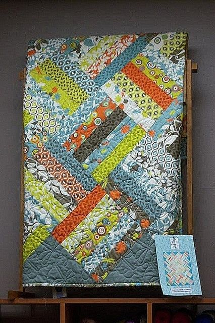 Jelly Roll Quilt – blocks of five strips on the diagonal.                                                                                                                                                                                 More