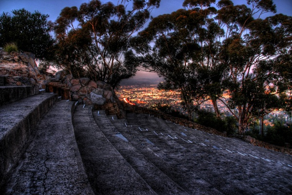 Ampitheater stairs on Mt. Helix overlooking the lights of El Cajon California at sunset. By Paul Koester.