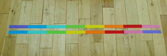 2. I then glued the shorter strips together to form two long 'rainbow' strips.