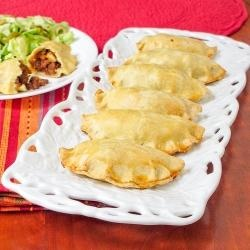 Empanadas are a popular snack in Argentina. They are miniature pies with chicken, vegetables, seafood, or beef inside.