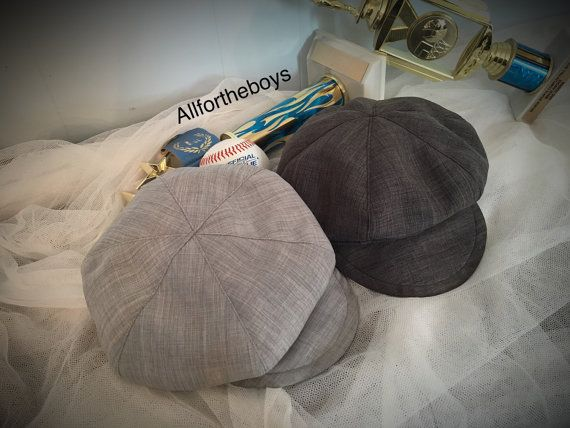 Baby Sizes Newspaper boy hat/ beret hat for boys Listing for ONE beret with satin lined beret Baby Size Small 16 - 19 Fits NEWBORN 0-6 MONTHS NEWSBOY HAT Beautiful hat is lined with a satin liner Added Elastic towards the back for size adjustment. Listing is for ONE BERET HAT ONLY.